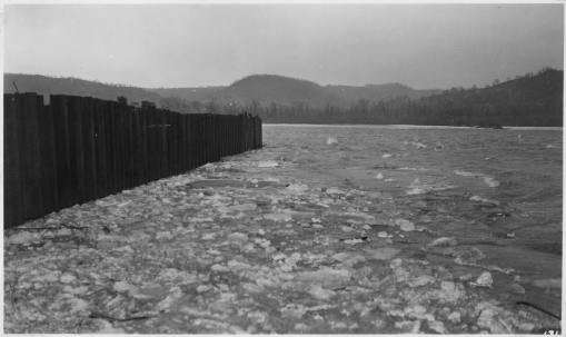 photograph_with_caption_-birdseye_view_of_cofferdam_looking_down_river_from_liberty_peak_at_beginnng_of_ice-_-_nara_-_282420